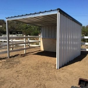 KRE 12x12 Two Sided Shelter With Tin And Plywood Siding And A Tin Roof